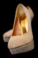Sona's pair of wedding shoes detail by Resh Rall Wedding Photography, Leeds