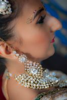 Sona's earing detail by Resh Rall Wedding Photography, Leeds