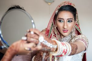 Sona's with mirror by Resh Rall Wedding Photography, Leeds