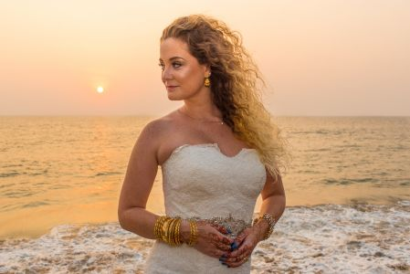 Resh Rall Photographs Abigail in bridal dress by the beach in India